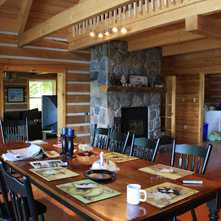 Dining room and fireplace of an Ecolog home