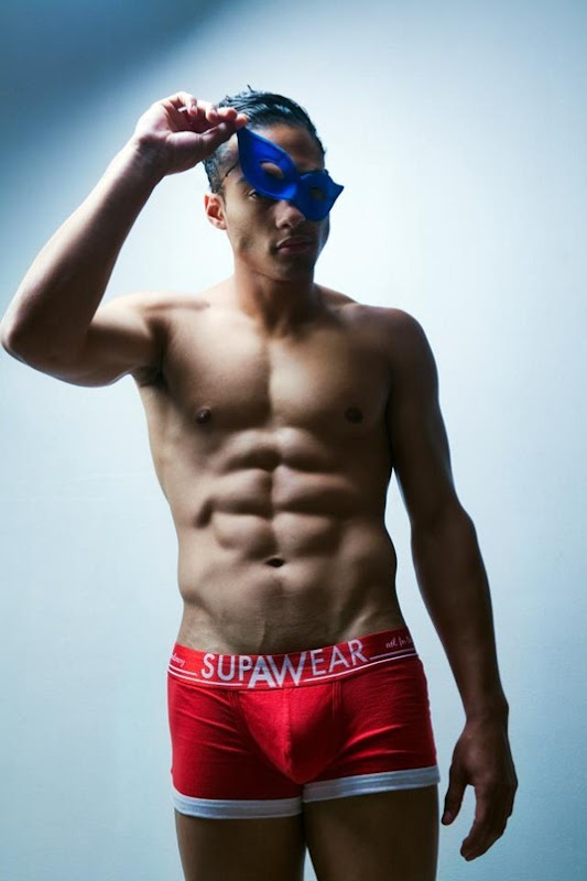 male model in mask and brief