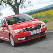 2013-Skoda-Rapid-Sedan-Red-Color-7.jpg