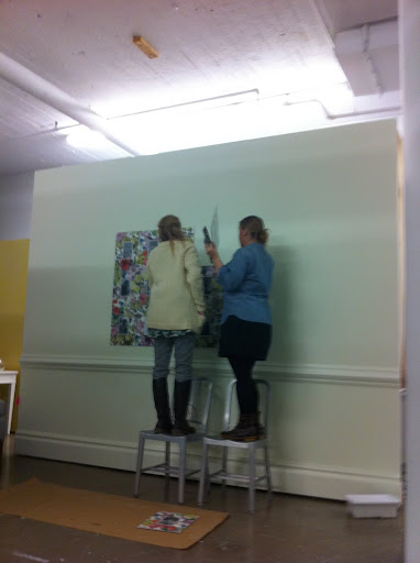 Here are Yvette and Kerstin hanging the prints the night before the shoot.