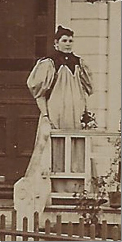 Bertha in front of house c 1895 cropped