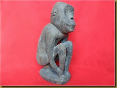 Primitive monkey wooden statue