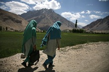 Two scholars walk along a road on the way from Gilgit to Chitral.<br /><br />