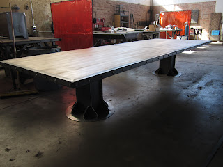 I Beam conference table with 14' aged maple top