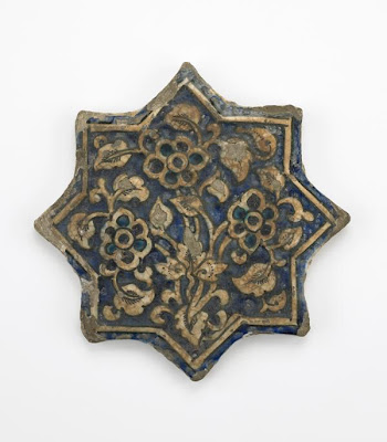 Tile | Origin:  Iran | Period: 14th century  Il-Khanid period | Details:  Not Available | Type: Stone-paste, molded and painted under glaze | Size: H: 2.2  W: 23.8  cm | Museum Code: F1903.200 | Photograph and description taken from Freer and the Sackler (Smithsonian) Museums.