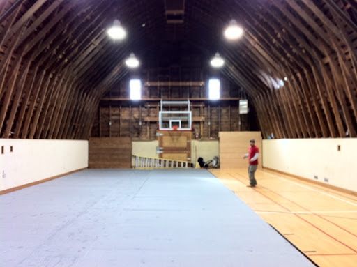 The next step was to cover the lines of the gym floor by laying carpet.