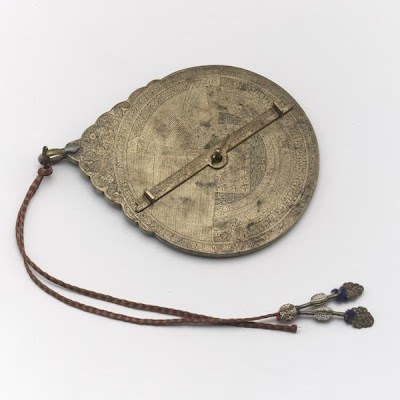Astrolabe | Origin:  Iran | Period: late 19th century | Details:  Not Available | Type: Brass | Size: H: 17.7  W: 12.9  cm | Museum Code: F1945.6 | Photograph and description taken from Freer and the Sackler (Smithsonian) Museums.