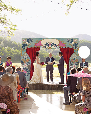 Large helium balloons add a playful touch to this wedding ceremony.