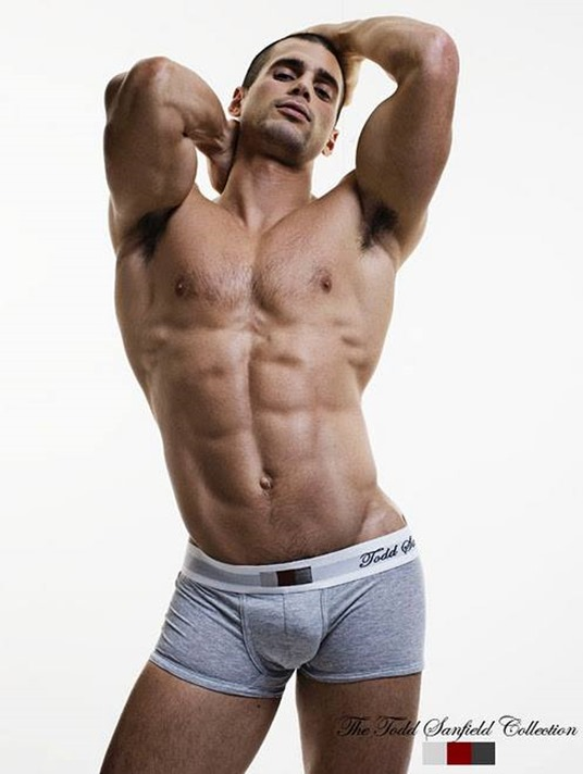 Todd Sanfield in gray trunks