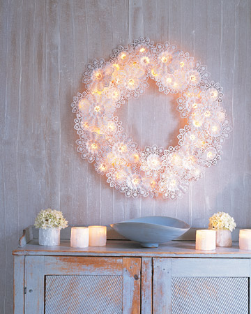 This wreath is completely made out of doilies and Christmas lights.