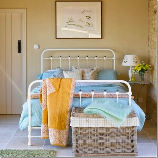 49-Extraordinary-Fresh-Summer-Bedroom-Designs-with-white-wall-wooden-door-blue-bed-pillow-yellow-blanket-nightstand-lamp-rattan-basket-carpet-ceramic-floor