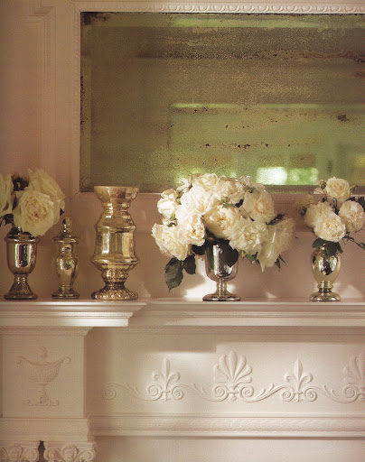 A voluptuous bouquet of white roses is part of a dazzling group with two smaller bouquets and pieces from Martha's prized collection of Victorian mercury glass. (The Best of Martha Stewart Living -- Arranging Flowers)