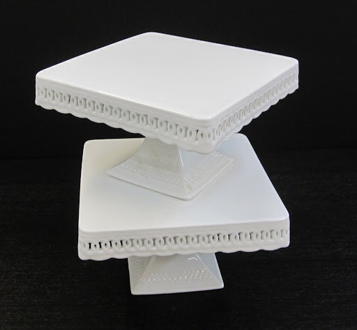 These are two cake stands stacked on top of one another. Their design is very elegant and romantic.