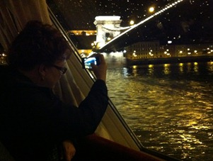 Melody and I are both trying to get picture on this dark rainy night with our iPhones from the boat on the Danube under the Chain Bridge