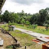 写真3: 天然林地域の村(Rh. Hassan) / Photo 3: