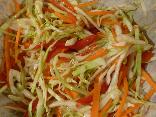 Coleslaw with hot cider vinegar dressing.
