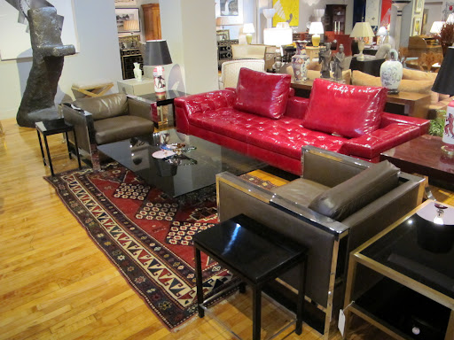 A sofa designed by Casa Desus in pomegranate patent leather - how fun! I love how it gives a modern twist to the older rug beneath.