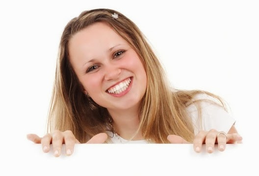 smiling-woman-behind-board