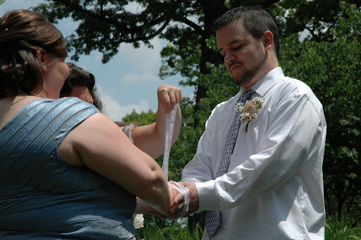 Jodi and Corey with the hand fasting ceremony