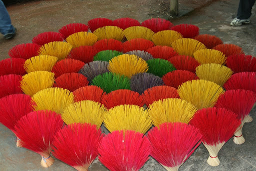 A colourful display of incense sticks, inviting a smelly demise.