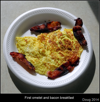 First omelet and bacon breakfast