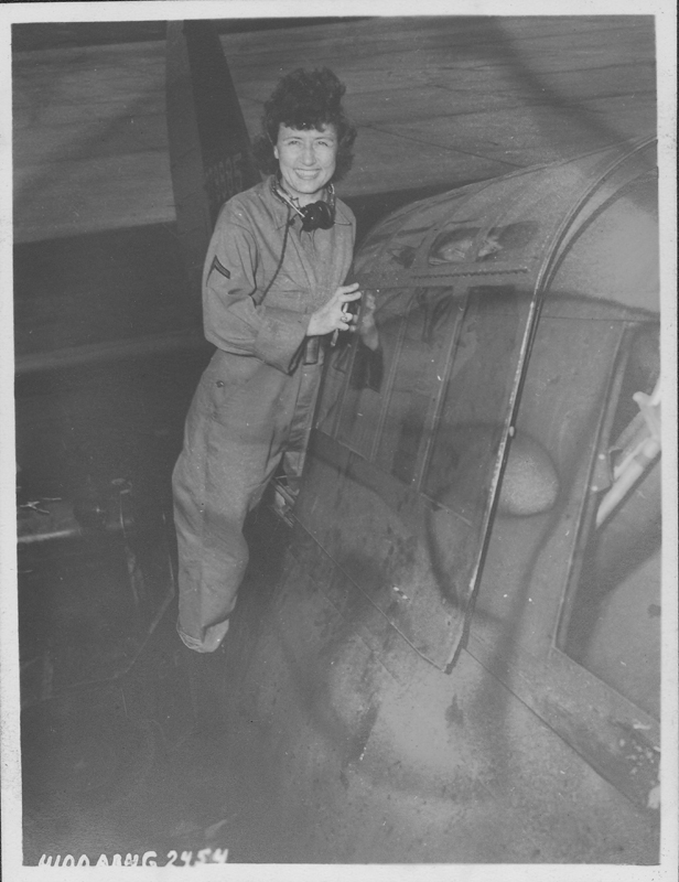 Women's Army Corps (WACS) servicewoman Esther Fromm working on a plane at Patterson Field. Circa 1944.