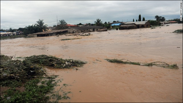 Floodwaters course through Odo Ona in Nigeria's Oyo State in 2011. At least 102 people were killed when a dam burst during torrential rain. Photo: AFP / Getty Images