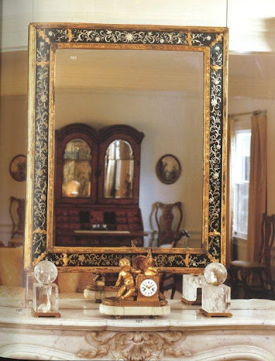 I know it's hard not to stare at the foil and gilt-framed mirror, but my eyes were immediately drawn to the pair of rock-crystal ornaments (no doubt an influence of Duquette) set atop the mantle.