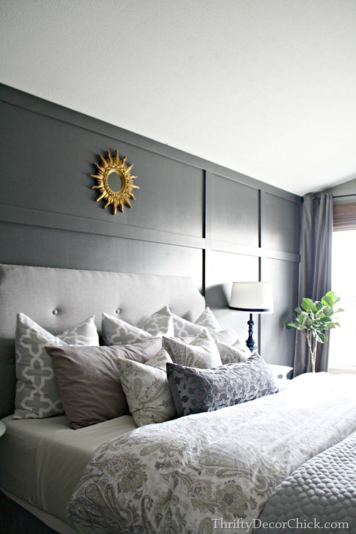 dark gray paneled wall