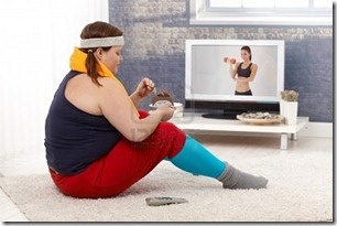 12472243-fat-woman-sitting-on-floor-with-chocolate-cake-while-watching-fitness-program-on-television