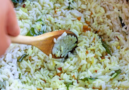 Combing fried spices and cooked rice