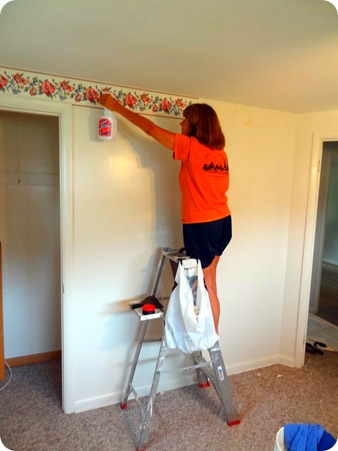 Marsha removing wallpaper.