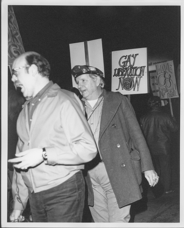 "Morris Kight (center) leads a Gay Liberation Front (GLF) protest at Barney's Beanery regarding their posting of ""Fagots [sic] Stay Out"" signs. 1969."