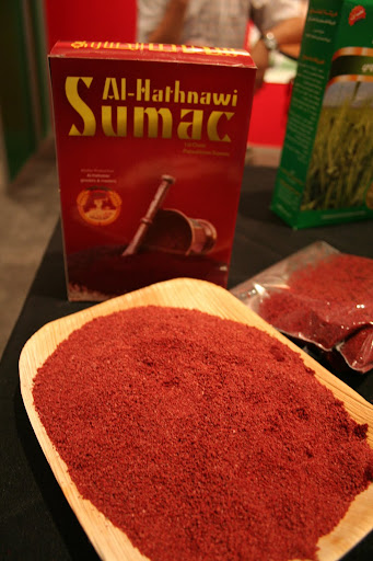 If za'atar is old hat for you, here's another Middle Eastern/North African spice to try: sumac.  It's the key to adding lemony flavor to many dishes, from everyday hummus to the Palestinian chicken dish Musakan.