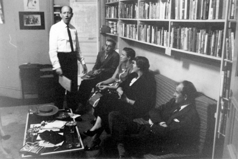 W. Dorr Legg stands before ONE Incorporated staff and author Harry Otis (far right). Circa 1957-1958.