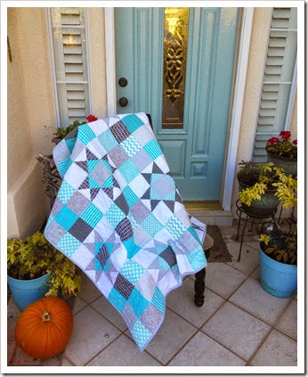 Gray and turquoise quilt