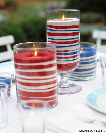 Red, white, and blue bands of sand dress up votive candles to make flickering lights that are cheerful and fun.  <http://www.marthastewart.com/photogallery/patriotic-crafts#slide_23>