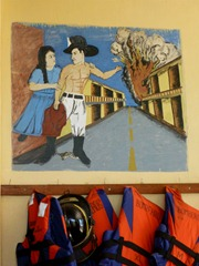 Painting in a Panamanian firehall depicting the truth about firemen.