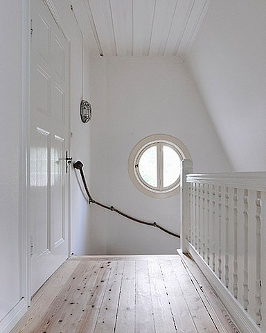 A simple way to add railings to a stairwell. (via apartmenttherapy.com)