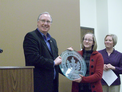 Bruce Hamous presenting the LEED Certified plaque to Director Debbie Stanton