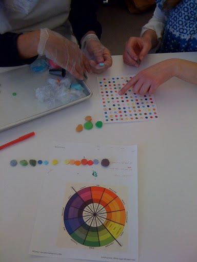 Britni and Elizabeth met to review the colors and placement of the dots.