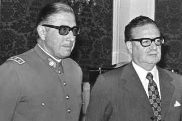 General Augusto Pinochet (L) poses with Chilean president Salvador Allende 23 August 1973 in Santiago.jpg