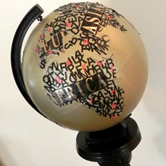 typographical art globe with upcycled pedestal square