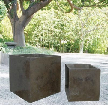 The distressed finish on these boxes makes the planters look both modern and aged. (treillage.com)