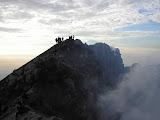 Hikers on Merapi crater rim at dawn (Daniel Quinn, October 2011)