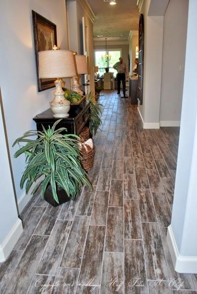 Distressed engineered wood floors entry way