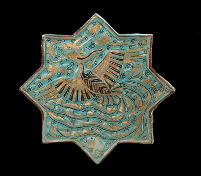 "Tile | Origin:  Takht-i Sulayman,  Iran | Period: 14th century  Il-khanid period | Details:  In the Islamic world, ceramics makers emphasized brightly colored glazes and intricate designs to animate relatively simple shapes and architectural tiles. Drawing on a variety of decorative sources, they continually expanded and refined their repertoire of calligraphic, abstract, and figurative motifs. Some of the designs, such as the soaring phoenix on this fourteenth-century turquoise molded tile, reflect Iran's contacts with other artistic traditions, in particular China. Such ""exotic"" motifs became an integral part of the Persian visual language and were skillfully adapted to satisfy local taste and aesthetic preferences. 