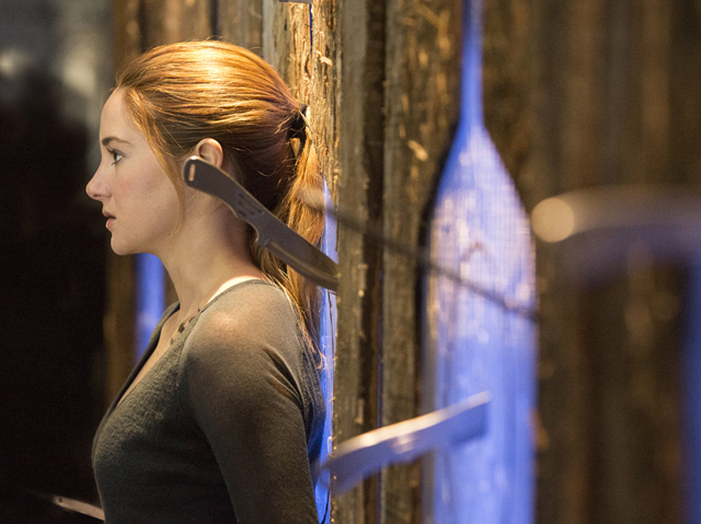 Shailene Woodley plays Beatrice Prior in the movie Divergent (March 2014), based on the dystopian young adult novel by Veronica Roth. The hugely popular book contains themes of economic struggle and class warfare. Photo: Jaap Buitendijk / Summit