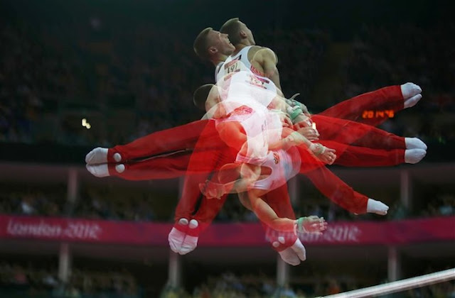 Denis Ablyazin of Russia competes in the horizontal bar event during the men's gymnastics qualification in the North Greenwich Arena during the London 2012 Olympic Games July 28, 2012. Picture taken with multiple exposures. REUTERS/Mike Blake