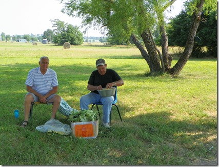 Don & Dennis, shucking corn, getting ready to feed the masses